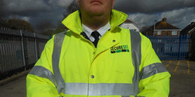 Security guard in hi-vis jacket