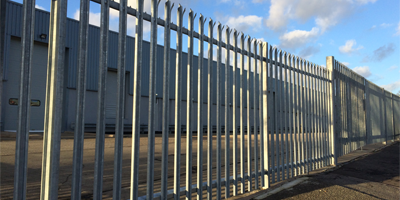 Palisade fencing protecting industrial units