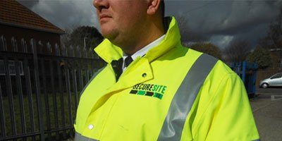 Static security guard on site by palisade fencing