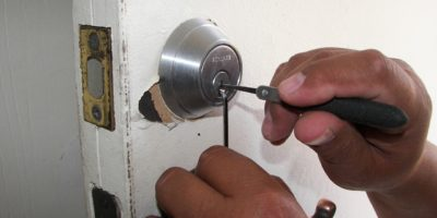 A locksmith working on a lock