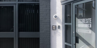 CCTV camera and access control badge reader outside office
