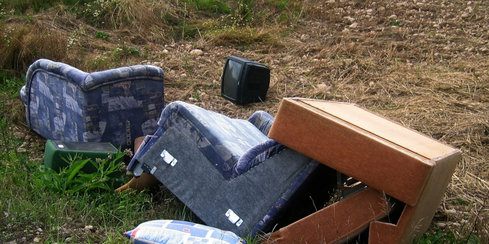 Fly-tipped/dumped household rubbish including sofa and TV